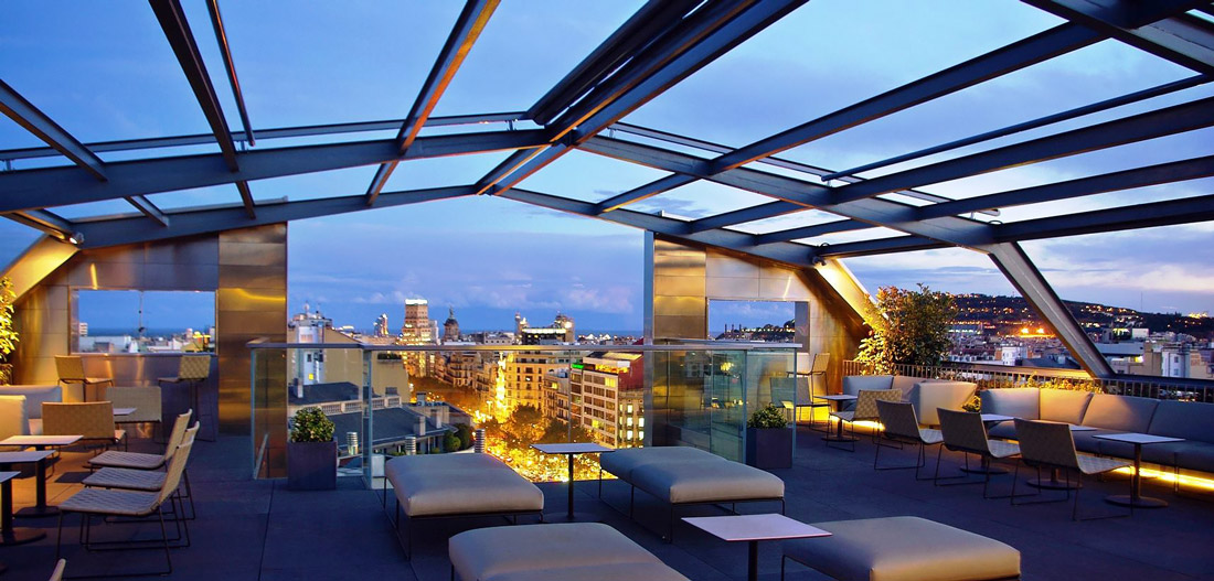 Glass-enclosed rooftop terrace